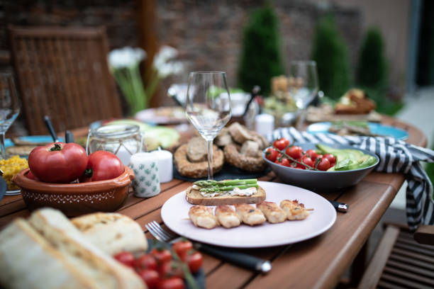 Close up of a dining table and food stock photo
