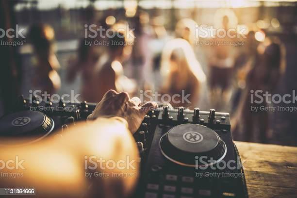 Close up of a dj playing music on the beach party picture id1131864666?b=1&k=6&m=1131864666&s=612x612&h=ppq0b2zdjy02zfabtptcqlydyez7nkxfclzbi qsyww=