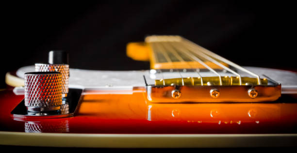 Close up of a electric guitar Close up of an Electric Guitar with a sunburst paint job string instrument stock pictures, royalty-free photos & images