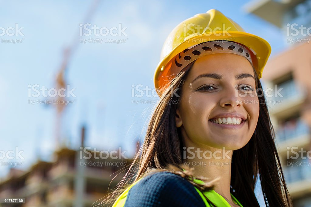 Close up of a female engineer at construction site stock photo