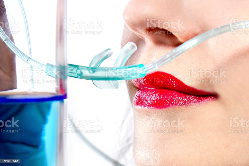 Close Up of a Female Inhaling in an Oxygen Bar stock photo