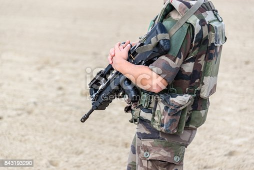 istock Close up of a French soldier with an automatic riffle, war and emergency state concept 843193290