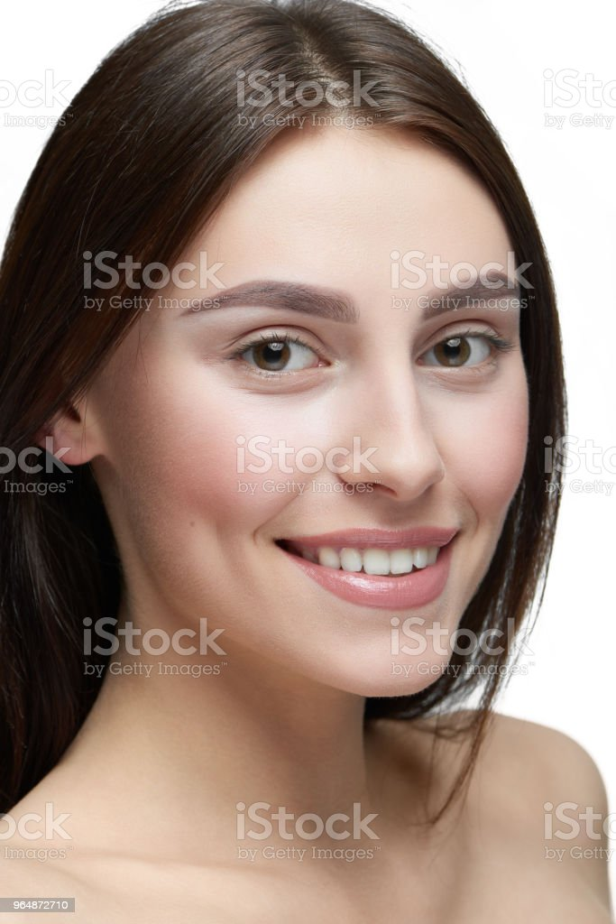 Close up of a girl with light day make up looking at camera. royalty-free stock photo