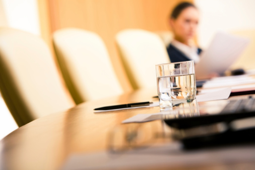 Close Up Of A Glass Of Water On A Conference Table Stock Photo - Download Image Now