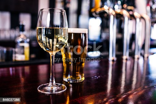 istock Close up of a glass of wine and a beer 846037086