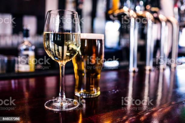 Close up of a glass of wine and a beer picture id846037086?b=1&k=6&m=846037086&s=612x612&h=occnacrvpexw0ocaq9yebzy89etoxo tvwshbdqwtbq=