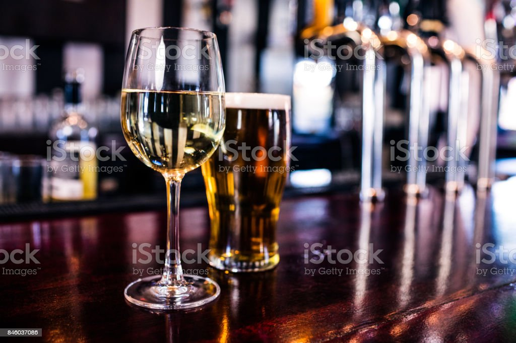 Close up of a glass of wine and a beer stock photo
