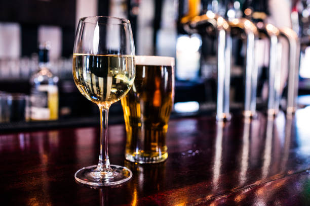 close up of a glass of wine and a beer - beer alcohol stock pictures, royalty-free photos & images