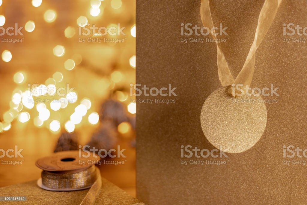 Close up of a glitter covered gift bag and tag in gold stock photo