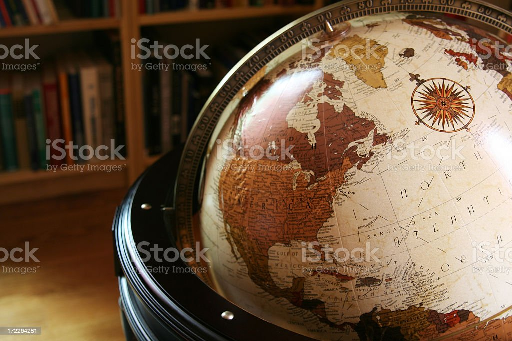 Close up of a globe in a library stock photo