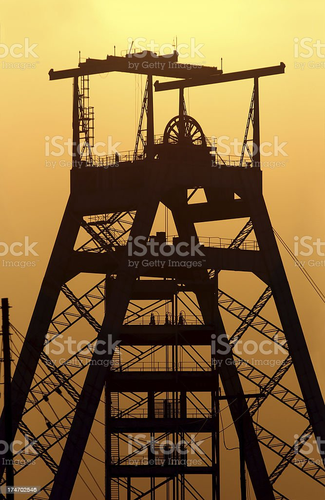 Close up of a gold mine head gear at sunset. royalty-free stock photo