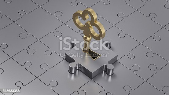 istock Close up of a golden key and metal puzzle. 513633368