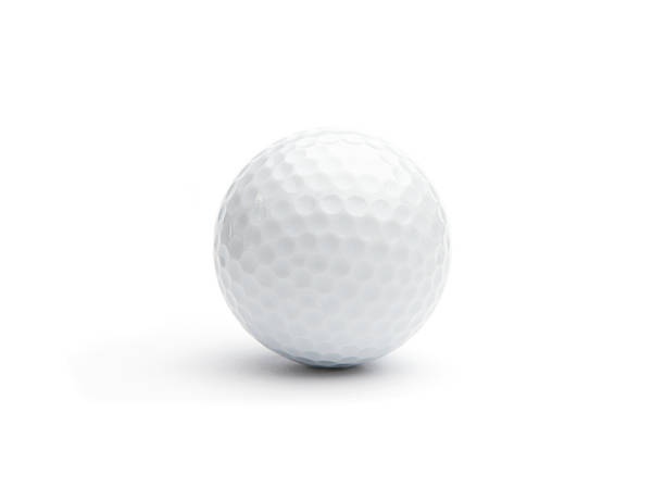 Close up of a golf ball on white background stock photo