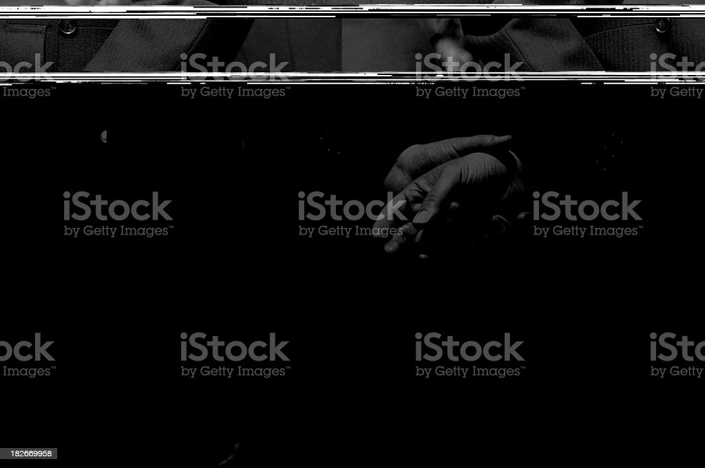 Close up of a grooms hands folded together. stock photo
