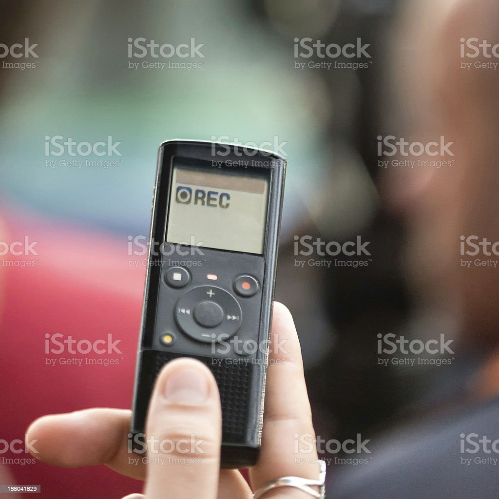 Close up of a hand holding a Dictaphone stock photo