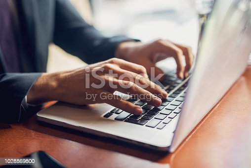 Close up of a hands of a businessman on a keyboard.