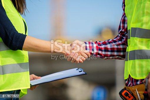 617878058 istock photo Close up of a handshake 617877522