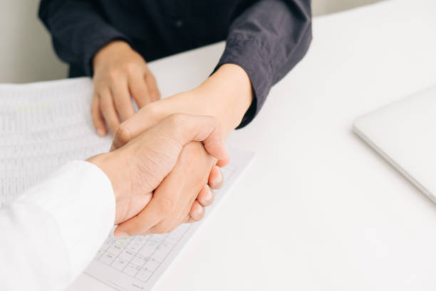 close up of a handshake - contributor stock pictures, royalty-free photos & images