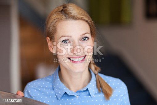 istock Close up of a happy young woman who has a braid. 1132337355