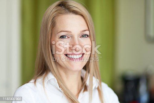 istock Close up Of A healthy Smiling woman. Looking at the camera 1132337302