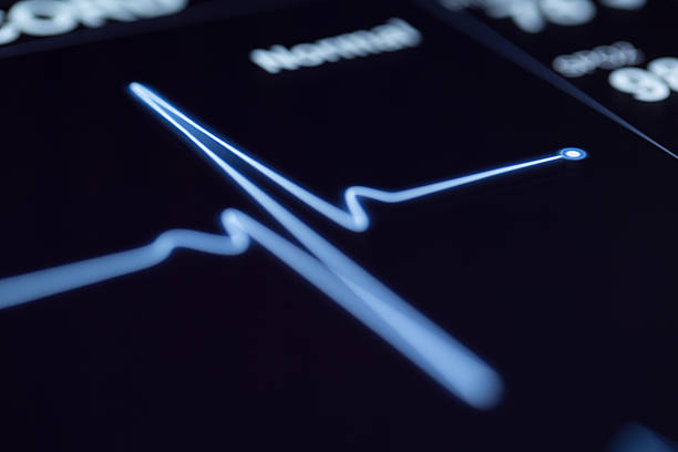 close up of a heartbeat on a machine - taking pulse stock photos and pictures