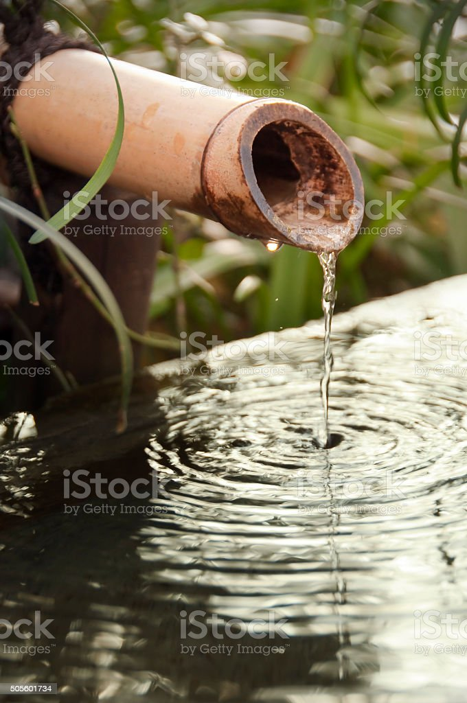Close up of a japanese bamboo fountain stock photo