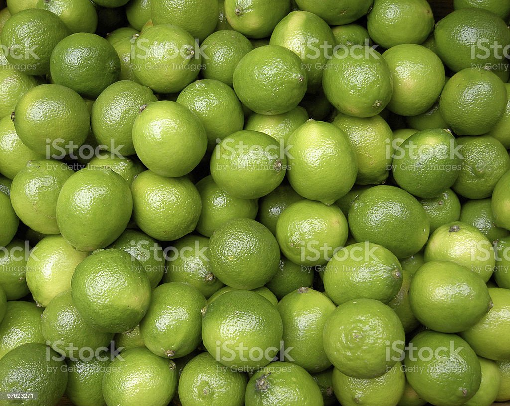 Close up of a large collection of green limes royalty-free stock photo