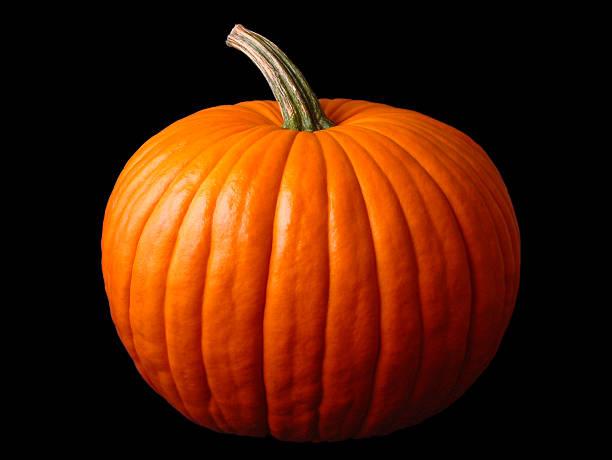 Close up of a large Halloween pumpkin Big halloween pumpkin on black pumpkin stock pictures, royalty-free photos & images