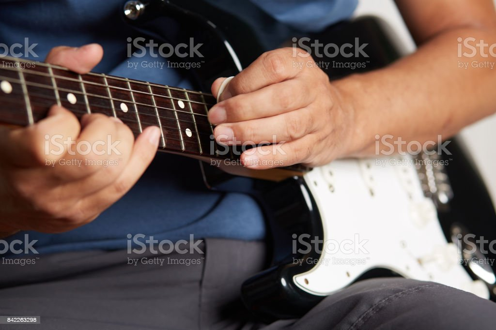 Close up of a lefty electric guitar being played stock photo