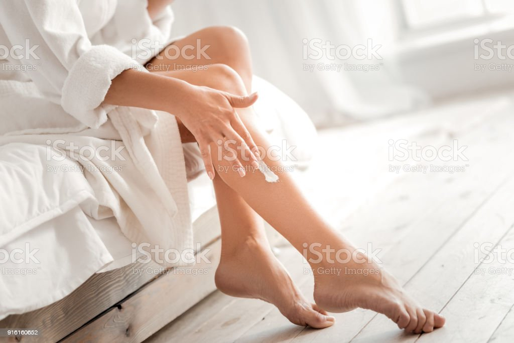 Close up of a leg with cream on it stock photo