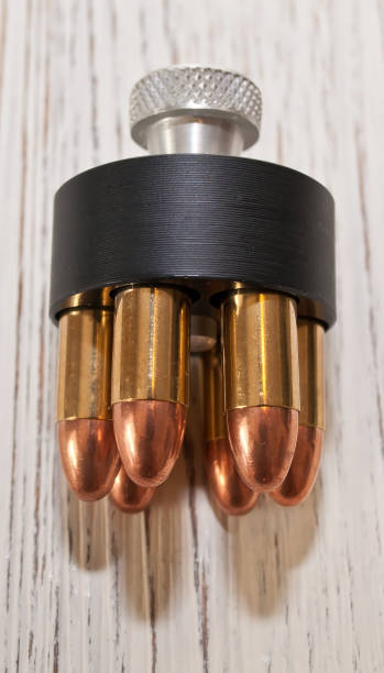A close up of a loaded speed loader for a revolver stock photo