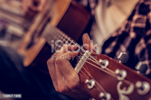 istock Close up of a male hand holding the guitar 1098011956