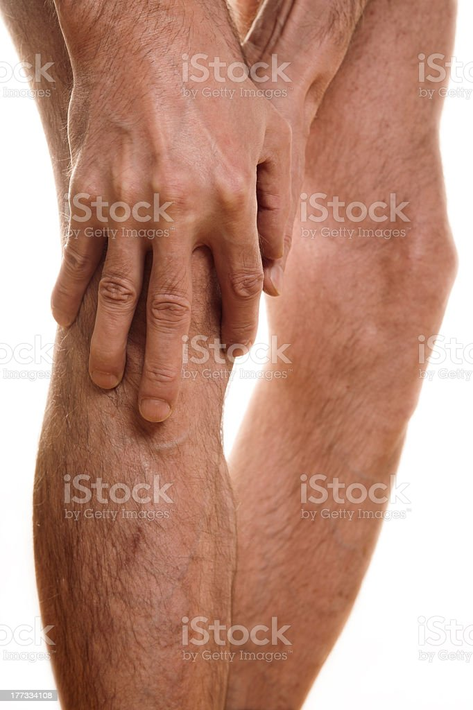 Close up of a man holding his knee royalty-free stock photo