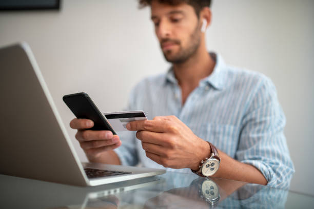 Close up of a man paying with credit card. stock photo