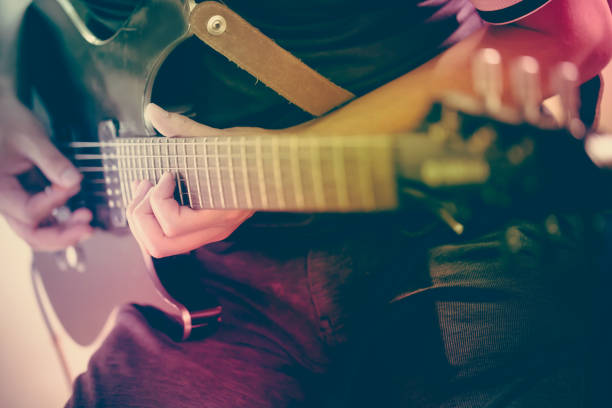 Close up of a man playing electric guitar stock photo