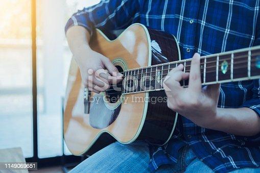 istock close up  of a man playing guitar 1149069651