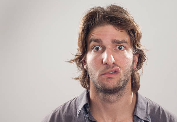 Close up of a man with puzzled look on his face stock photo