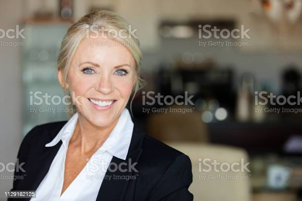 Close Up Of A Mature Lawyer Smiling Stock Photo - Download Image Now