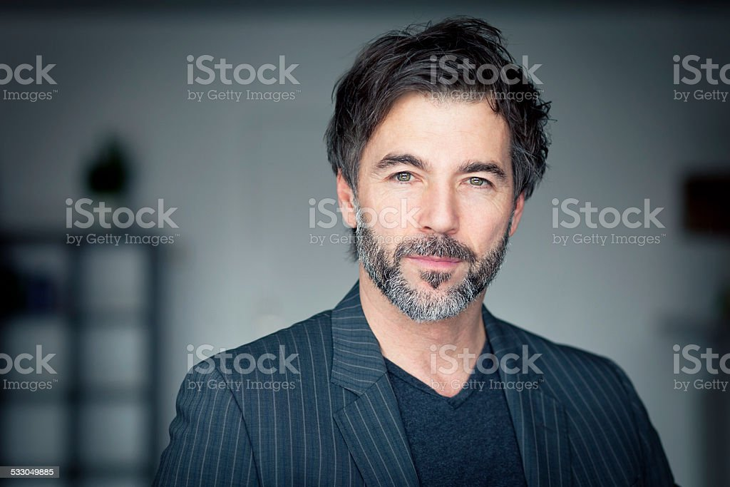 Close up OF A Mature Man Looking At The Camera stock photo