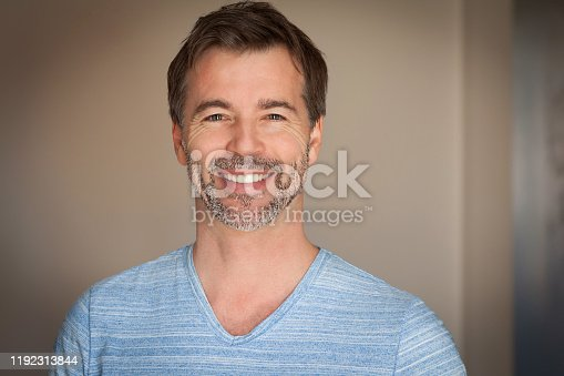 637538262istockphoto Close up Of A Mature Man Smiling At The Camera. Casual shirt. Happy man 1192313844