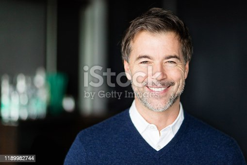 Close Up Of A Mature Man Smiling At The Camera. Handsome businessman.