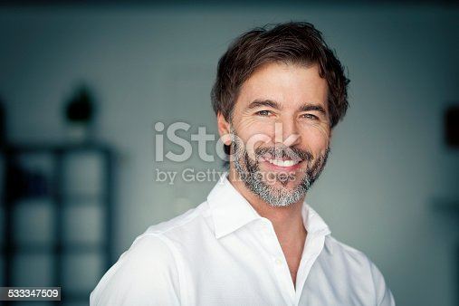 istock Close Up Of A Mature Man Smiling At The Camera 533347509