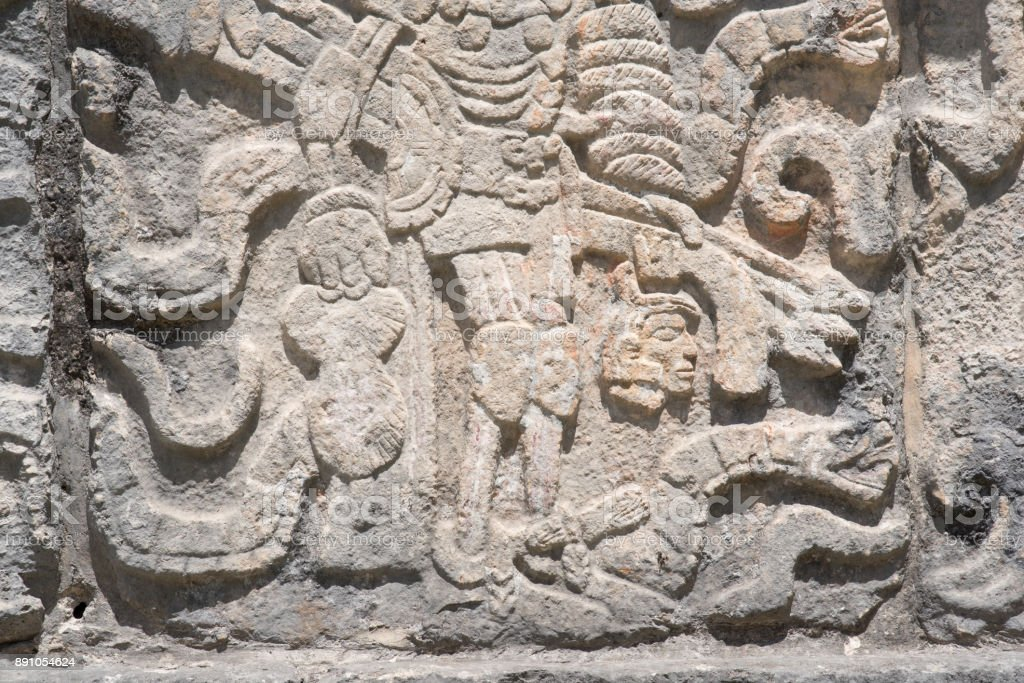 Close up of a Mayan warrior with severed head stone carving at the Mayan ruins at Chichen Itza stock photo