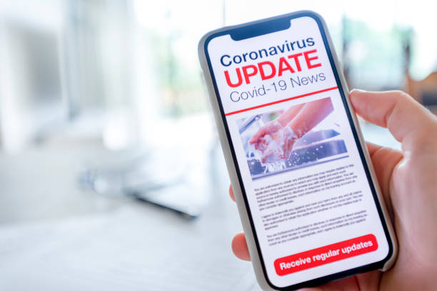 Nahaufnahme eines Mobiltelefons mit Coronavirus covid-19 News-Update. – Foto