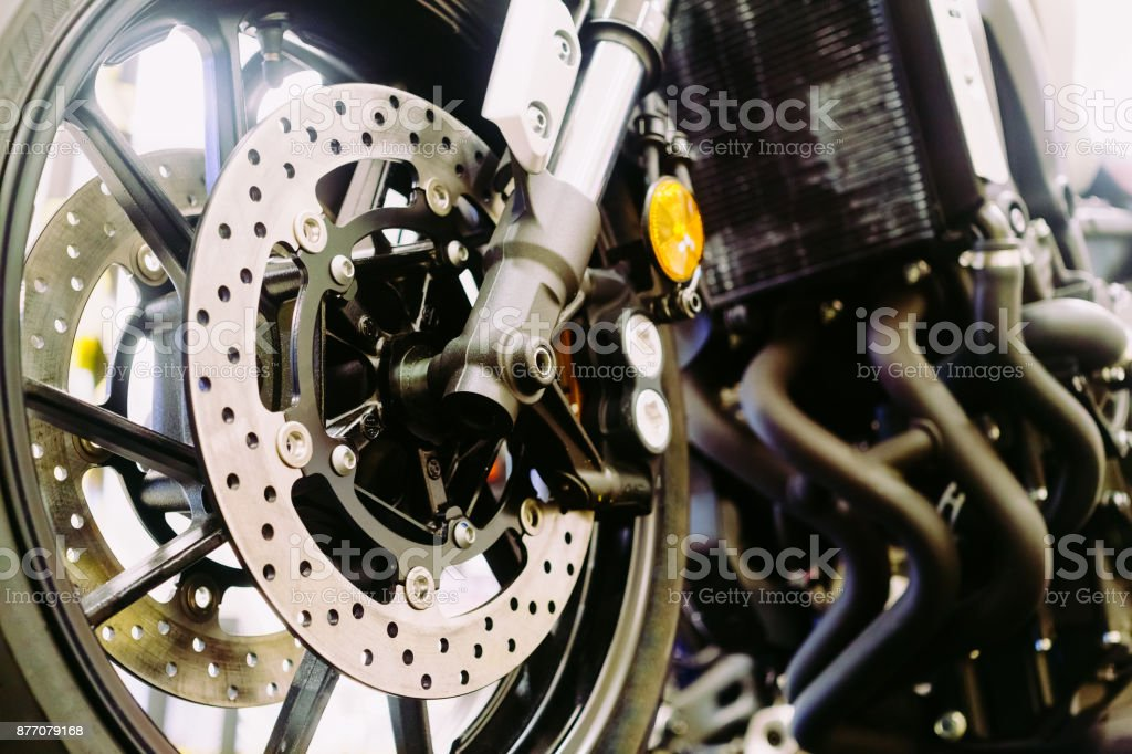 Close up of a motorcycle wheel, Suspension and disc brake system of modern motorcycle's front wheel. stock photo