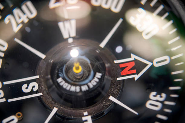 close up of a naval compass with bokeh stock photo