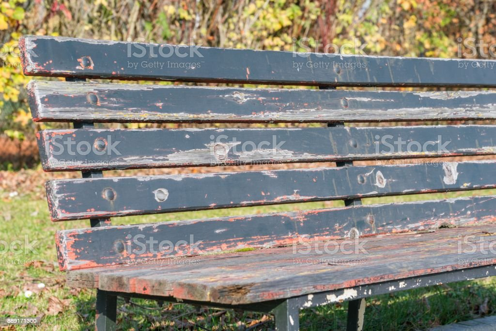 Close up of a park bench in a public park stock photo