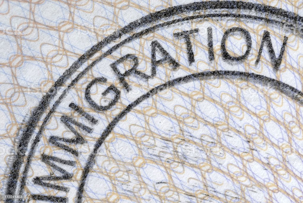 Close up of a passport immigration stamp royalty-free stock photo