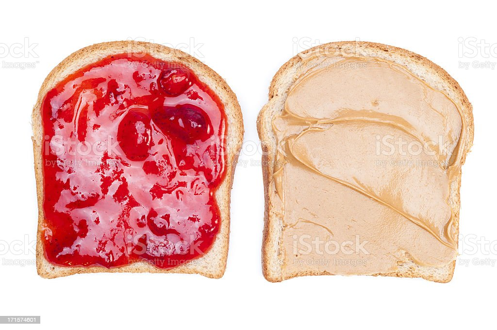 Close up of a peanut butter & jelly sandwich on white bread stock photo