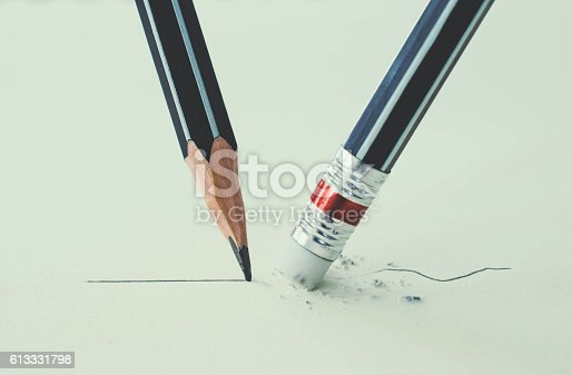 istock Close up of a pencil eraser removing a crooked line 613331798